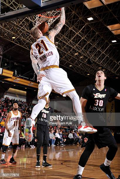 Nick Minnerath of the Canton Charge dunks the ball against Daniel Coursey of the Erie BayHawks at the Canton Memorial Civic Center on December 19...