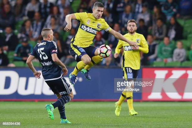 Nick Montgomery of Central Coast Mariners competes for the ball against Alan Baro of the Victory during the round 27 ALeague match between the...