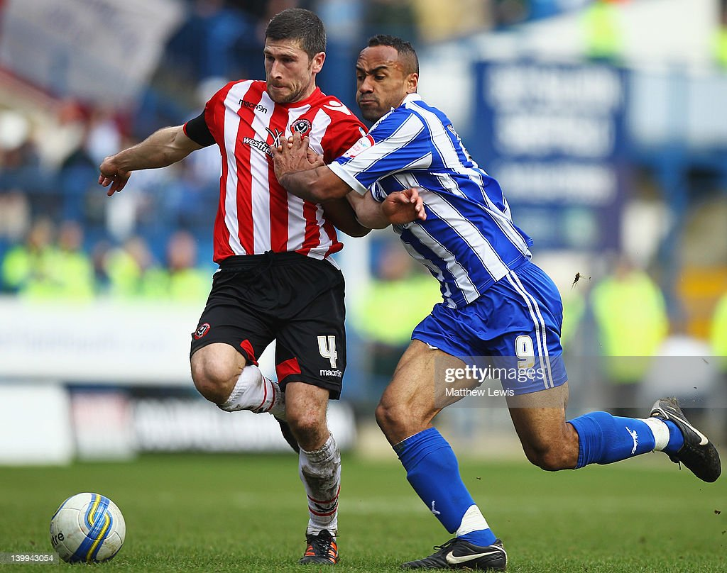 Nick Montgomery of Sheffield United and Chris O'Grady of Sheffield Wednesday challenge for the ball during the npower League One match between Sheffield Wednesday and Sheffield United at Hillsborough Stadium on February 26, 2012 in Sheffield, England.