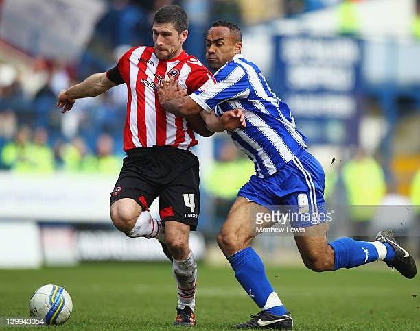 Nick Montgomery of Sheffield United and Chris O'Grady of Sheffield Wednesday challenge for the ball during the npower League One match between...