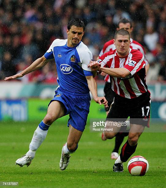 Nick Montgomery of Sheffield United and Paul Scharner of Wigan Athletic battle for the ball during the Barclays Premiership match between Sheffield...