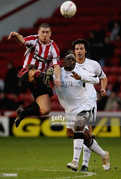 Nick Montgomery of Sheffield United battles with Adebayo Akinfenwa of Swansea during the FA Cup sponsored by EON Third Round match between Sheffield...