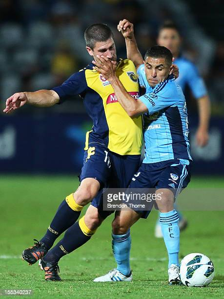 Nick Montgomery of the Mariners competes with Ali Abbas of Sydney during the round five ALeague match between the Central Coast Mariners and Sydney...