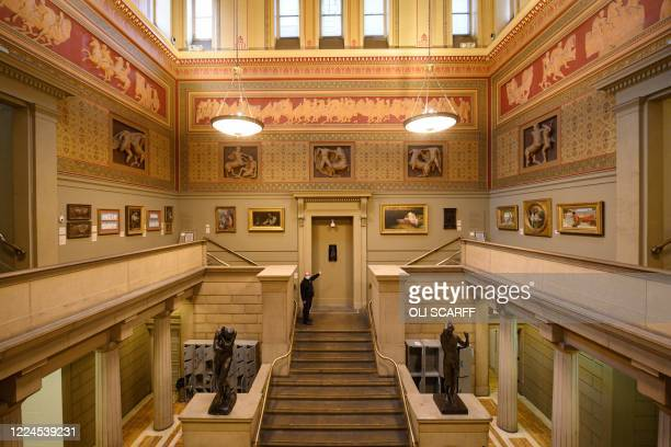 Nick Mooney, a visitor services assistant at Manchester Art Gallery, inspects the galleries that are due to reopen to the general public next month,...