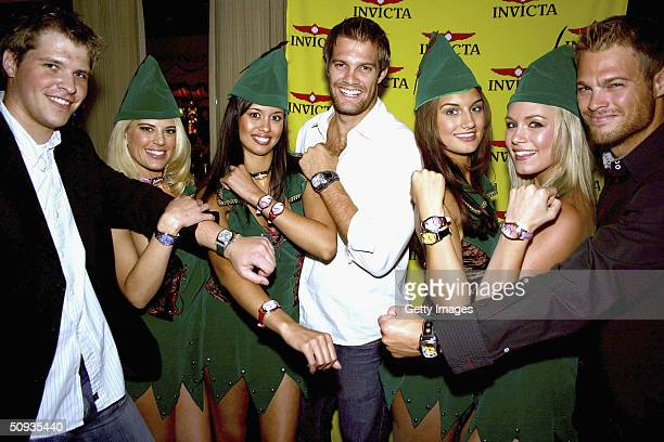 Nick Motil Amy Miller Rachael Mortensen Geoff Stults Andrea Tiede Rachelle Leah and George Stults wearing Invicta watches pose for a photo on June 5...