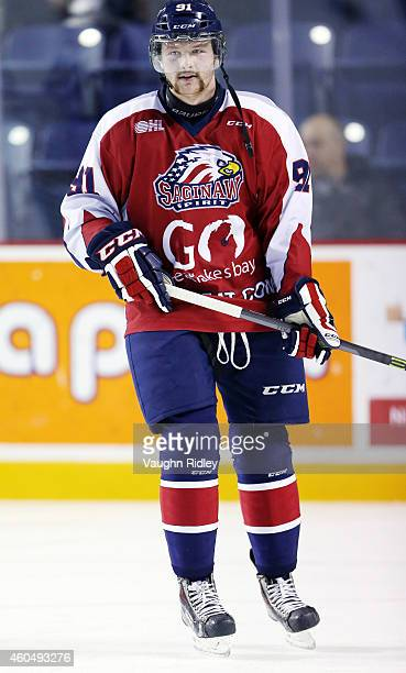 Nick Moutrey of the Saginaw Spirit takes part in warm ups during an OHL game between the Saginaw Spirit and the Niagara IceDogs at the Meridian...
