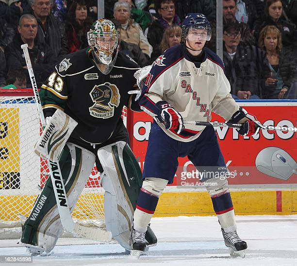 Nick Moutrey of the Saginaw Spirit waits for a shot to tip in front of Anthony Stolarz of the London Knights in an OHL game on February 24 2013 at...