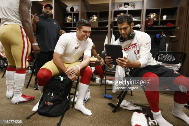 Nick Mullens and Jimmy Garoppolo of the San Francisco 49ers relax in the locker room prior to the game against the Washington Redskins at FedExField...