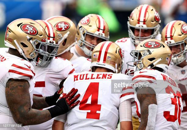 Nick Mullens of the San Francisco 49ers and the offense huddles in the fourth quarter against the New York Giants at MetLife Stadium on September 27,...