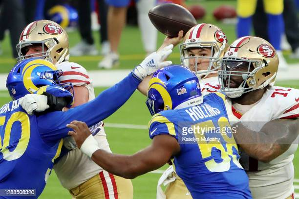 Nick Mullens of the San Francisco 49ers attempts to throw a pass during the second half against the Los Angeles Rams at SoFi Stadium on November 29,...