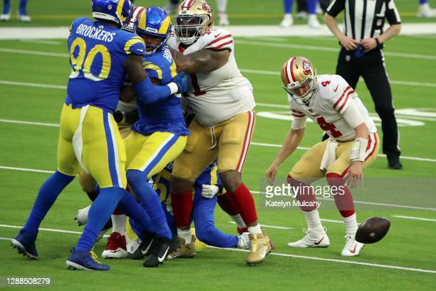 Nick Mullens of the San Francisco 49ers fumbles the ball during the second half against the Los Angeles Rams at SoFi Stadium on November 29, 2020 in...