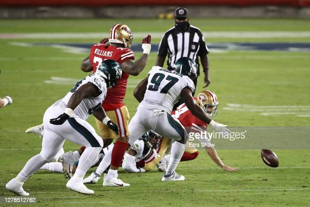 Nick Mullens of the San Francisco 49ers fumbles the ball in the fourth quarter against the San Francisco 49ers in the game at Levi's Stadium on...