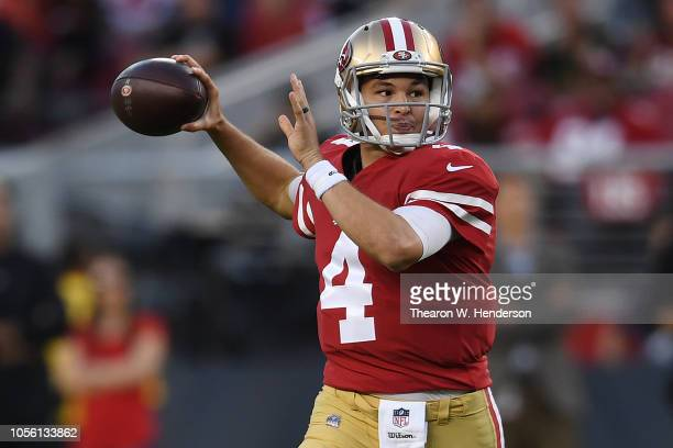 Nick Mullens of the San Francisco 49ers looks to pass against the Oakland Raiders during their NFL game at Levi's Stadium on November 1, 2018 in...