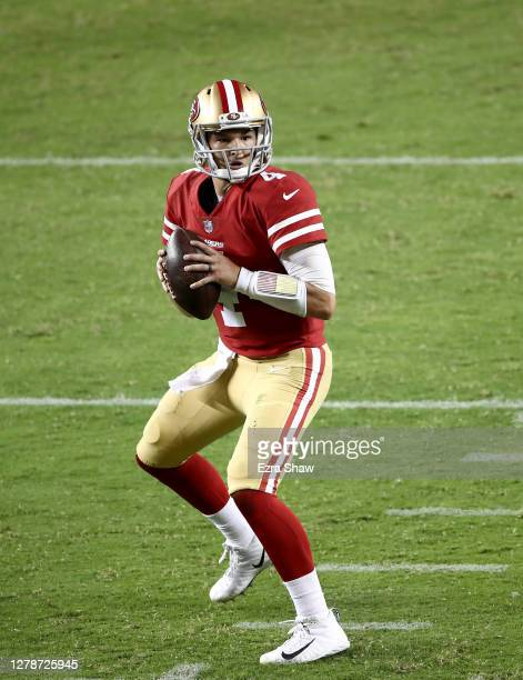 Nick Mullens of the San Francisco 49ers looks to pass against the Philadelphia Eagles at Levi's Stadium on October 04, 2020 in Santa Clara,...