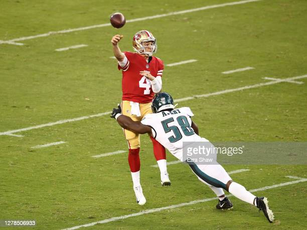 Nick Mullens of the San Francisco 49ers pass the ball against Genard Avery of the Philadelphia Eagles in the game at Levi's Stadium on October 04,...