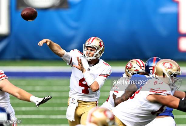 Nick Mullens of the San Francisco 49ers passes the ball in the first quarter against the New York Giants at MetLife Stadium on September 27, 2020 in...
