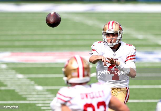 Nick Mullens of the San Francisco 49ers passes the ball to Ross Dwelley in the first quarter against the New York Giants at MetLife Stadium on...