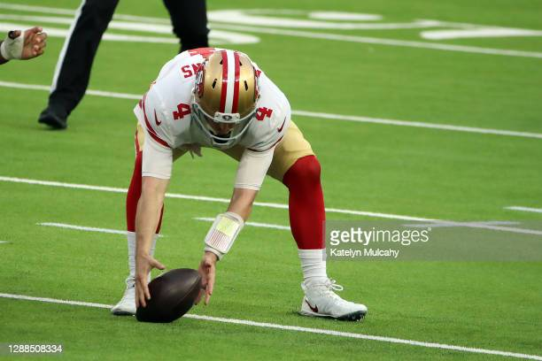 Nick Mullens of the San Francisco 49ers recovers his fumble during the second half against the Los Angeles Rams at SoFi Stadium on November 29, 2020...