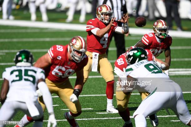 Nick Mullens of the San Francisco 49ers takes the snap during the second half against the New York Jets at MetLife Stadium on September 20, 2020 in...