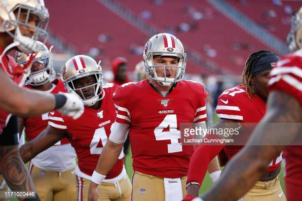 Nick Mullens of the San Francisco 49ers talks to teammates before the preseason game against the Los Angeles Chargers at Levi's Stadium on August 29,...