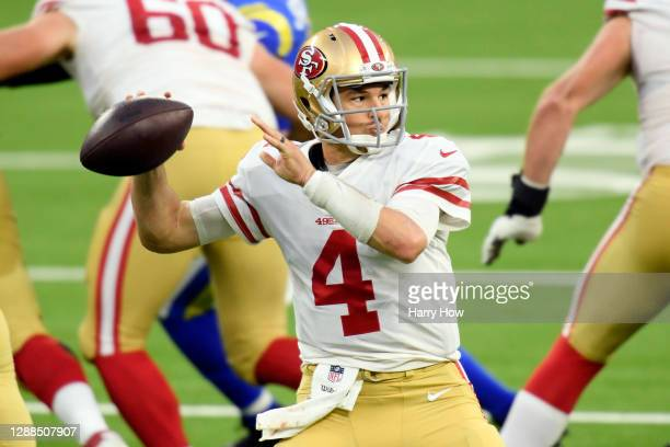Nick Mullens of the San Francisco 49ers throws a pass during the second half against the Los Angeles Rams at SoFi Stadium on November 29, 2020 in...
