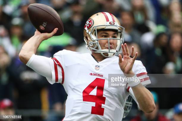 Nick Mullens of the San Francisco 49ers throws the ball in the first quarter against the Seattle Seahawks at CenturyLink Field on December 2, 2018 in...