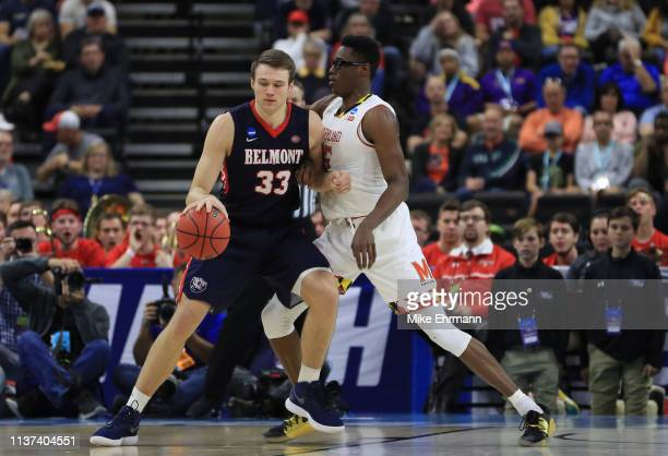 Nick Muszynski of the Belmont Bruins dribbles the ball against Jalen Smith of the Maryland Terrapins in the first half during the first round of the...