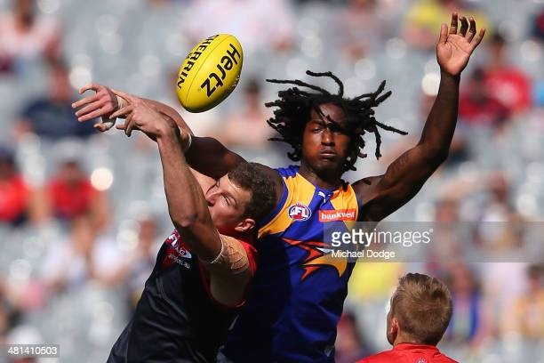 Nick Naitanui of the Eagles taps the ball over Jake Spencer of the Demons during the round two AFL match between the Melbourne Demons and the West...