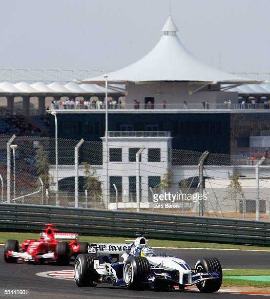 Nick Neidfeld of Germany and BMW Williams in action in front of Michael Schumacher of Germany and Ferrari during the fourth free practice for the...