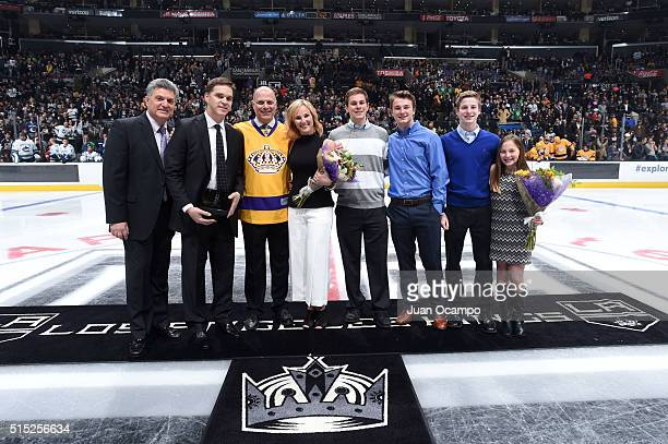 Nick Nickson Luc Robitaille Jimmy Carson and family pose for a photo during the LA Kings Legends Night prior to the game against the Vancouver...