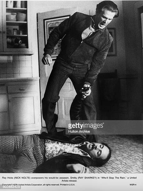 CIRCA 1978 Nick Nolte over powers Ray Sharkey in a scene from the United Artist movie Who'll Stop the Rain circa 1978