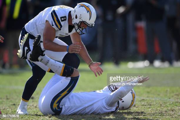 Nick Novak of the Los Angeles Chargers celebrates after kicking the game winning field goal as time expires in their NFL game against the Oakland...