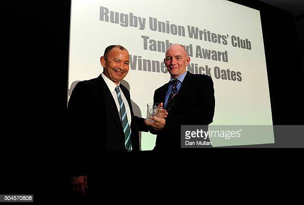 Nick Oates is presented with the Rugby Union Writers' Club Tankard Award by Eddie Jones Head Coach of England during the Rugby Union Writers' Club...
