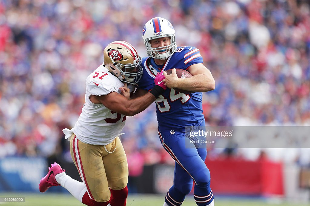 Nick O'Leary #84 of the Buffalo Bills breaks a tackle by Michael Wilhoite #57 of the San Francisco 49ers during the first half at New Era Field on October 16, 2016 in Buffalo, New York.