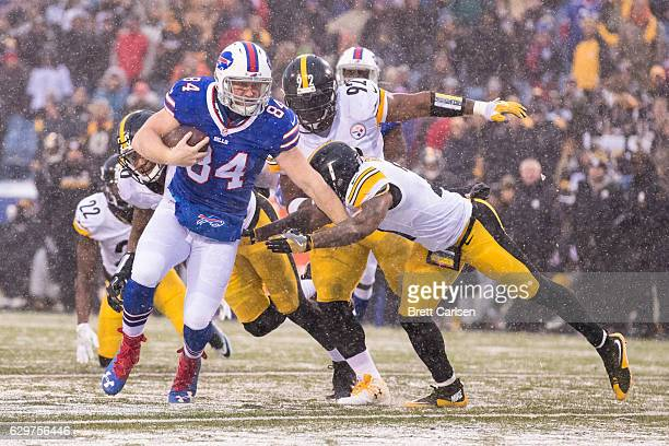 Nick O'Leary of the Buffalo Bills carries the ball during the fourth quarter against the Pittsburgh Steelers on December 11 2016 at New Era Field in...