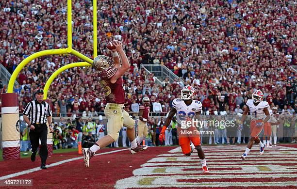 Nick O'Leary of the Florida State Seminoles catches a touchdown during a game against the Florida Gators at Doak Campbell Stadium on November 29 2014...