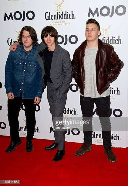 Nick O'Malley Alex Turner and Matt Helders of the Arctic Monkeys attend the Glenfiddich Mojo Honours List 2011 at The Brewery on July 21 2011 in...