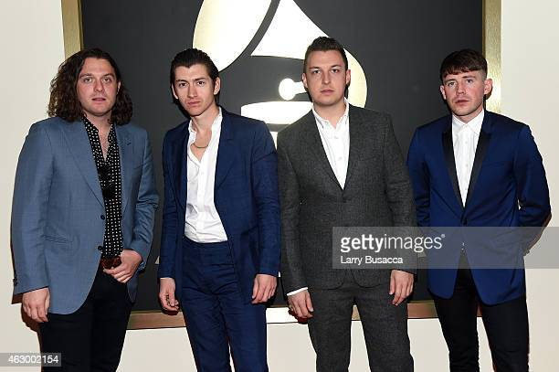 Nick O'Malley Alex Turner Matt Helders and Jamie Cook of Arctic Monkeys attend The 57th Annual GRAMMY Awards at the STAPLES Center on February 8 2015...