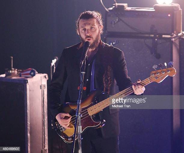 Nick O'Malley of Arctic Monkeys performs onstage during iHeartRadio Live Series With Arctic Monkeys held at iHeartRadio Theater on June 11 2014 in...