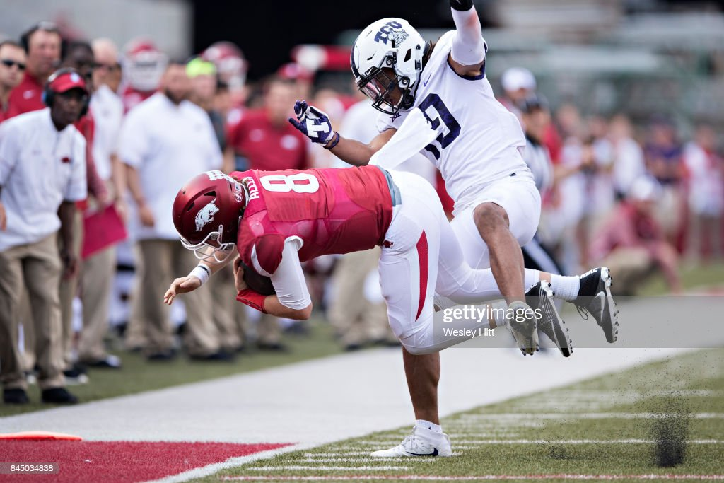 Nick Orr #18 of the TCU Horned Frogs knocks Austin Allen #8 of the Arkansas Razorbacks out of bounds at Donald W. Reynolds Razorback Stadium on September 9, 2017 in Fayetteville, Arkansas. The Horn Frogs defeated the Razorbacks 28-7.