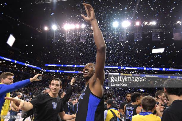 Nick Pagliuca and Harry Giles of the Duke Blue Devils celebrate following their 7569 victory against the Notre Dame Fighting Irish during the ACC...