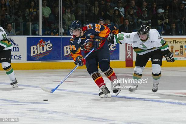Nick Palmieri of the Erie Otters eludes Sam Gagner of the London Knights in game played at the John Labatt Centre on January 12 2007 in London...