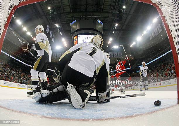 Nick Palmieri of the New Jersey Devils celebrates his first period goal against Brent Johnson of the Pittsburgh Penguins during the game at the...