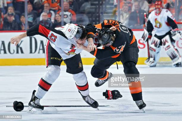 Nick Paul of the Ottawa Senators and Jakub Voracek of the Philadelphia Flyers fight in the first period at Wells Fargo Center on December 7 2019 in...
