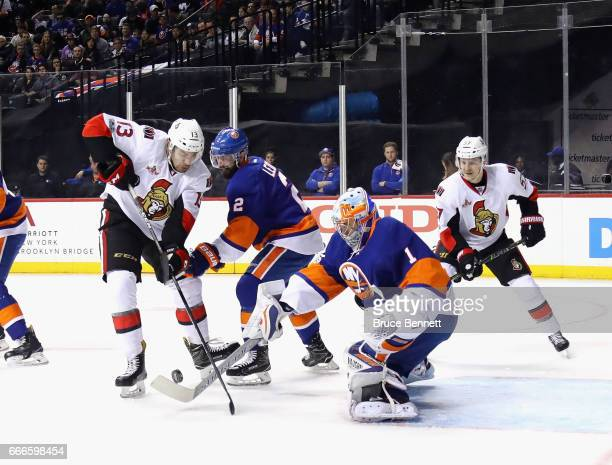 Nick Paul of the Ottawa Senators is stopped by Thomas Greiss of the New York Islanders during the first period at the Barclays Center on April 9 2017...