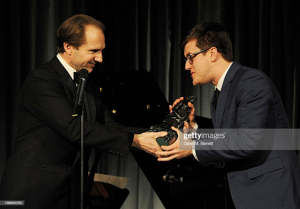 Nick Payne (R) accepts the award for Best Play for 'Constellations' from Ralph Fiennes at the 58th London Evening Standard Theatre Awards in association with Burberry at The Savoy Hotel on November 25, 2012 in London, England.