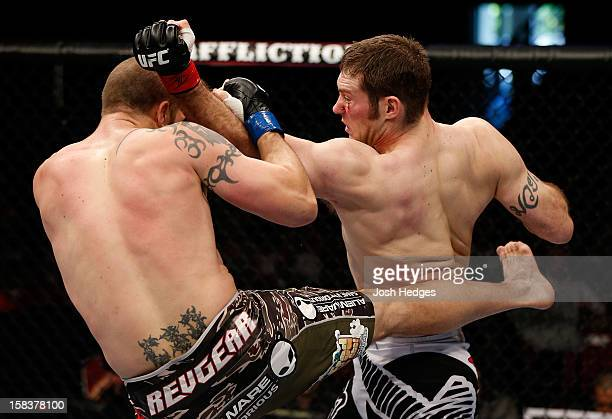 Nick Penner punches Cody Donovan during their light heavyweight fight at the UFC on FX event on December 15 2012 at Gold Coast Convention and...