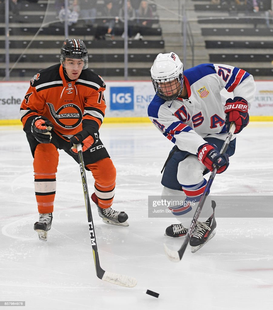 Nick Perbix #14 of the Omaha Lancers defends against Jake Goldowski #21 of Team USA in the first period during the game on Day 3 of the USHL Fall Classicat UPMC Lemieux Sports Complex on September 30, 2017 in Cranberry Township, Pennsylvania.