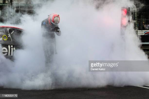 Nick Percat driver of the Brad Jones Racing Commodore ZB is climbs out from his car after it caught fire during race 2 on July 07, 2019 in...