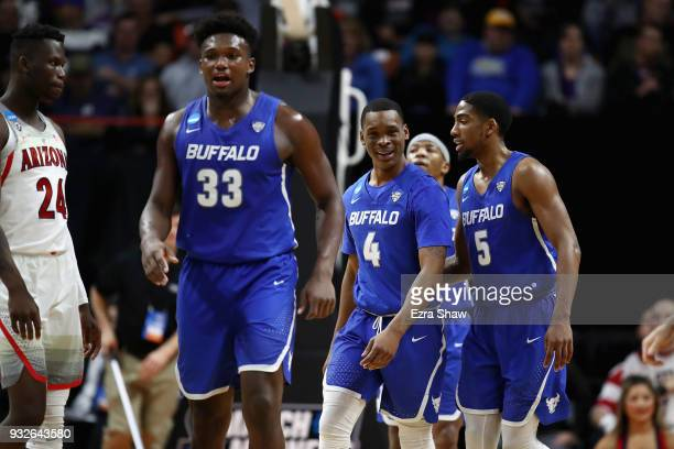 Nick Perkins Davonta Jordan and CJ Massinburg of the Buffalo Bulls react in the second half against the Arizona Wildcats during the first round of...